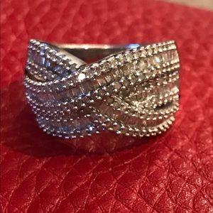 Elegant twist baguette & round silver diamond ring